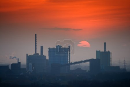 Industrial skyline at sunset