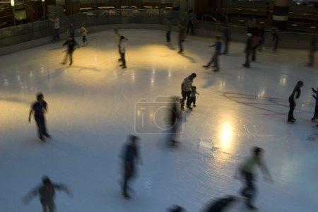 Ice skating indoor arena in america long exposure motion blur