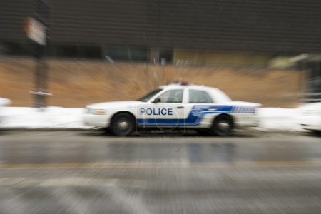 Police car blur effect in american city