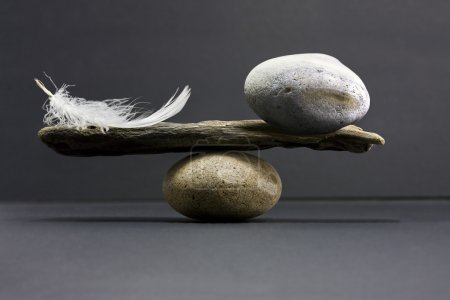 Photo for A feather and a stone equally balance - Royalty Free Image