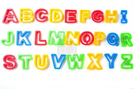 Photo pour Lettres de l'alphabet à partir de formes d'etter lstencil pour enfants - image libre de droit