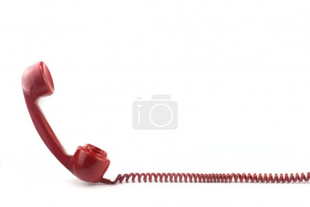 Old fashioned 1970's or 50's style red telephone...