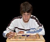 Boy playing Backgammon