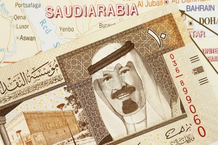 Photo for Close up shot of Saudi Arabia money and map. - Royalty Free Image