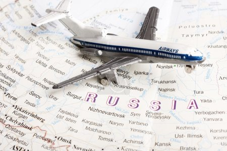 Photo for Travel to Moscow concept - with toy plane in russian map. - Royalty Free Image