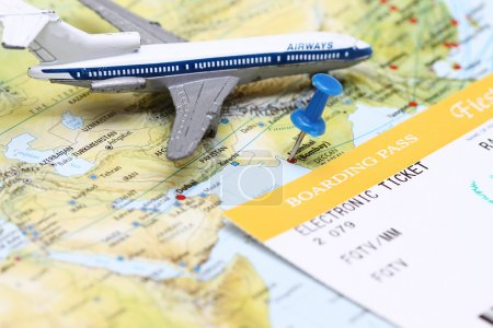Photo for Travel conceptual - a plane flying over India map with boarding pass. - Royalty Free Image