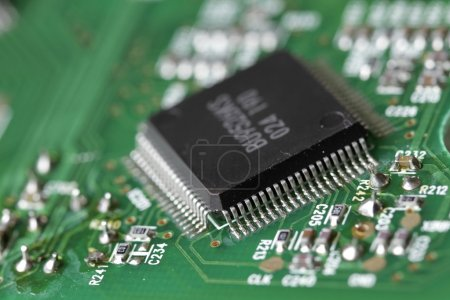 Photo for Macro shot of integrated circuit - many uses in the electronics industry. - Royalty Free Image