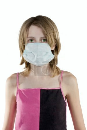 Girl in a protective mask
