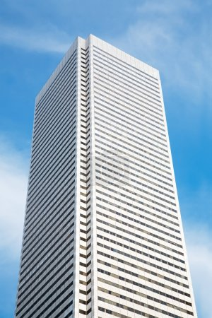 Photo for One very tall office building is displayed against a blue sky. - Royalty Free Image