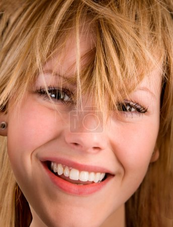 Young Blonde Girl with Messy Hair