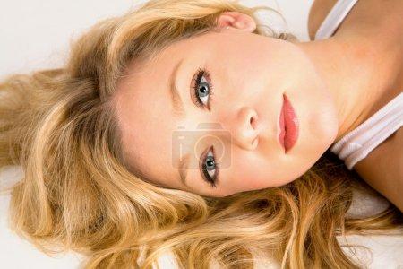 Beautiful Blonde Woman Laying Down