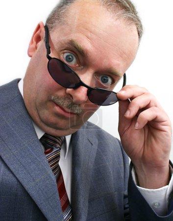 Businessman Takes Sunglasses Off