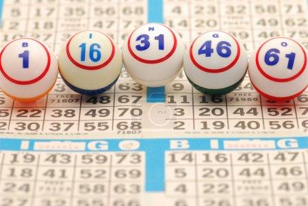 A close-up of five bingo balls spelling BINGO on a...