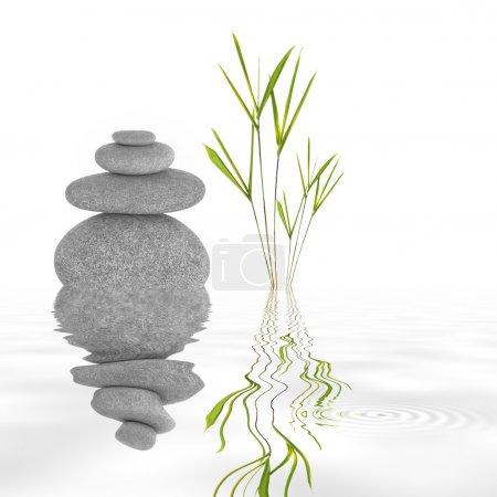 Photo pour Jardin zen abstrait de pierres grises en parfait équilibre et herbe de feuilles de bambou, avec réflexion dans l'eau ondulée, sur fond blanc . - image libre de droit