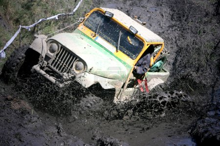 Extreme off-road. Roadster in the big mud