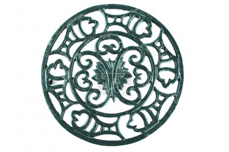Photo for Ornate old cast iron trivet - Royalty Free Image