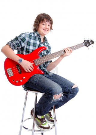 Teenager playing electric guitar
