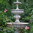 A tiered classic fountain in the garden....