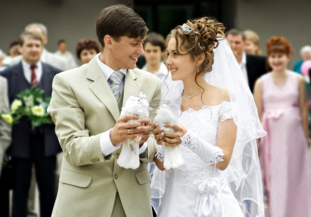 The groom and the bride hold a doves as peace and ...