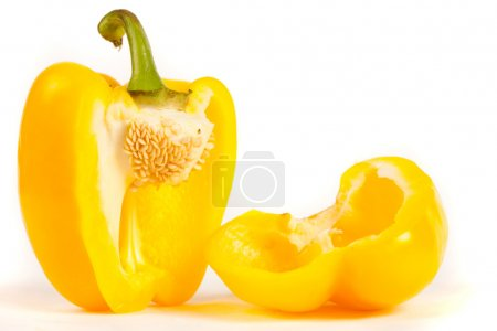 Photo for Close up of a sliced yellow pepper isolated on white background - Royalty Free Image
