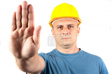 Blue collar worker making a stop sign