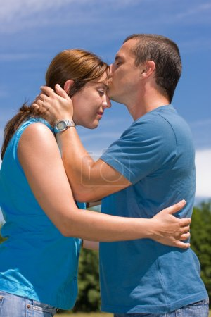 Photo for Loving couple under summer blue sky - Royalty Free Image