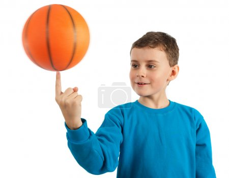 Kid spinning basketball with motion blur