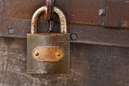 Close up of a rusty vintage padlock...