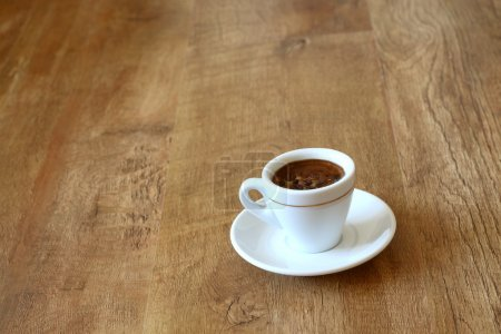 Photo for Cup of coffee on wood - Royalty Free Image