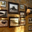 Pictures in frames hanging on an old wall...