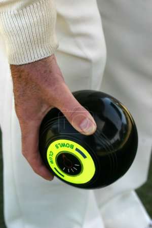 Photo for Man's hand holding lawn bowls ball - Royalty Free Image