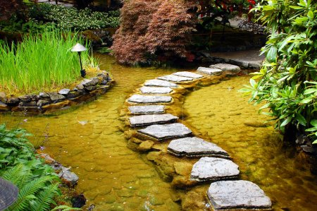 Photo for Stone path over garden pond - Royalty Free Image