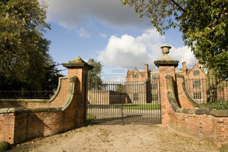 Photo for Closed gates at entrance to large house - Royalty Free Image