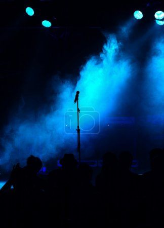 Empty blue stage with microphone