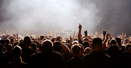 Photo for Concert crowd, fans raising hands, white light - Royalty Free Image