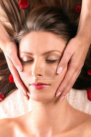 Pretty girl getting head massage