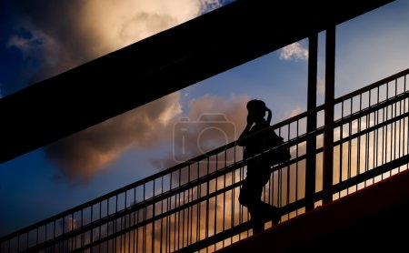 Silhouette of one woman use cellphone