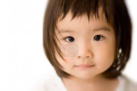 She is a beautiful Asian baby with innocent face....