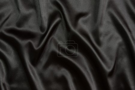 Black silk textile background