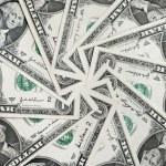Background of One dollar bills in circular arrange...