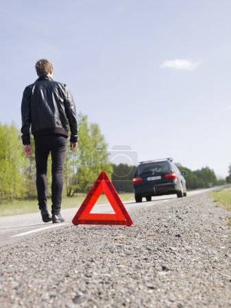 Photo for Warning triangle in front of a car breakdown - Royalty Free Image