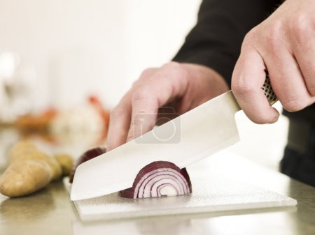 Cutting onion with a knife...