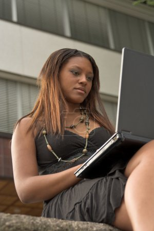 Pretty girl working with laptop