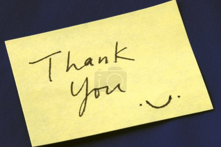 A Thank You note isolated on dark blue background...