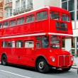 Red double deck bus at heritage route...