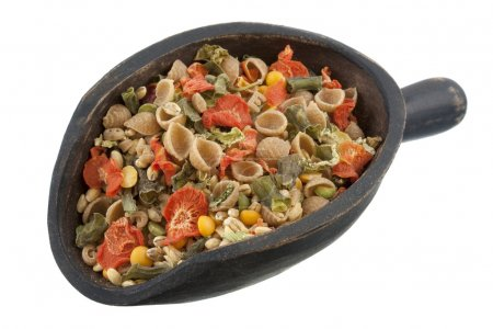 Scoop of whole wheat vegetable soup mix