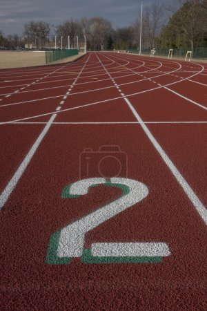 Lane number two on red running tracks
