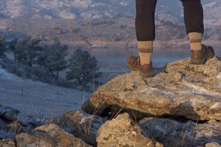 Hiker or trail runner legs on rock