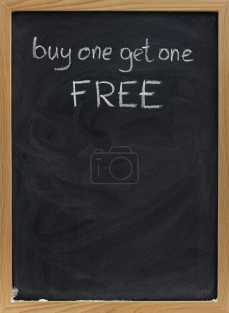 Discount sale advertisement on blackboard