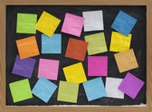 Colorful blank notes on blackboard